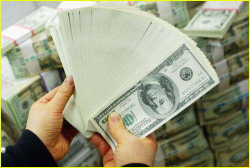 Money bills fanned out in a hand