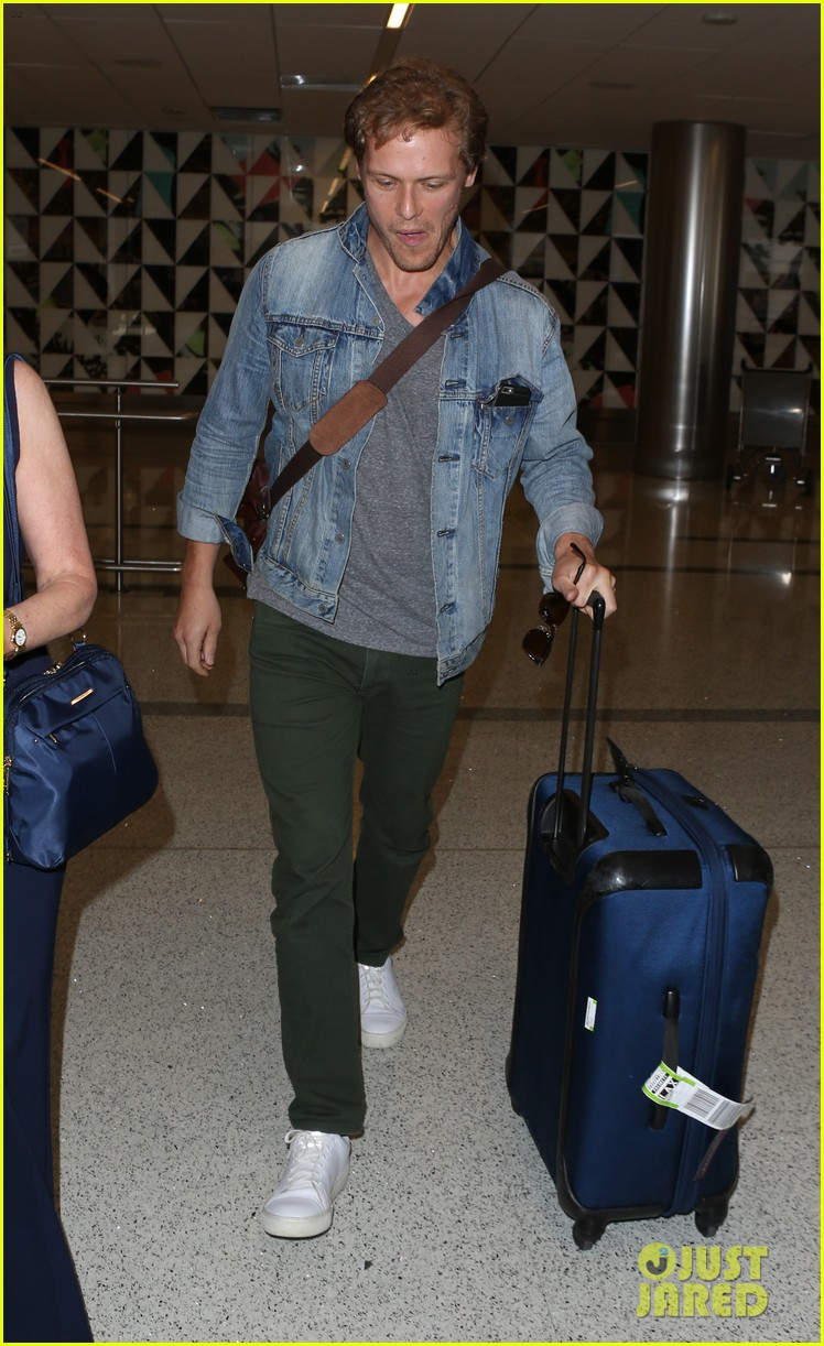 sam heughan greets his fans upon arrival in san diego 033931069