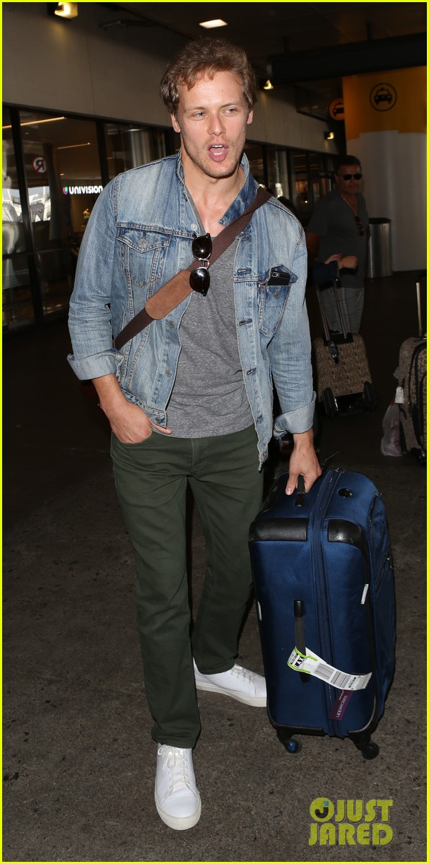 sam heughan greets his fans upon arrival in san diego 113931077