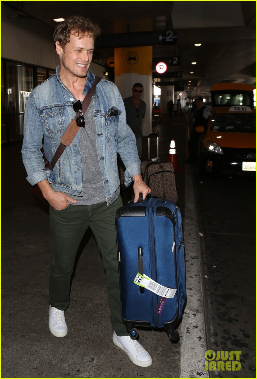 sam heughan greets his fans upon arrival in san diego 123931078