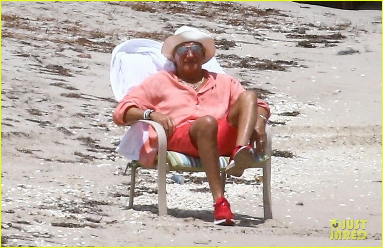 rod stewart sitting on the beach 014454231