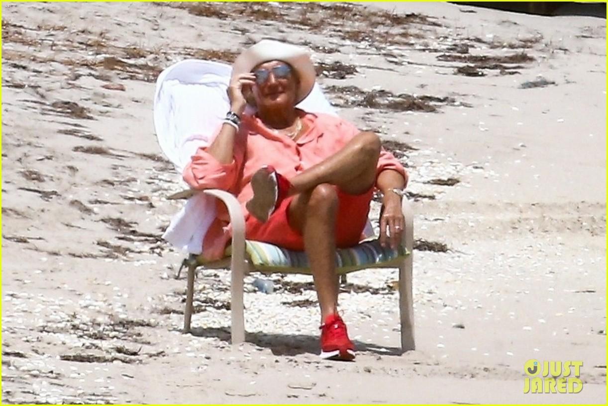 rod stewart sitting on the beach 034454233