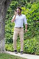 casey affleck takes call on his walk 05