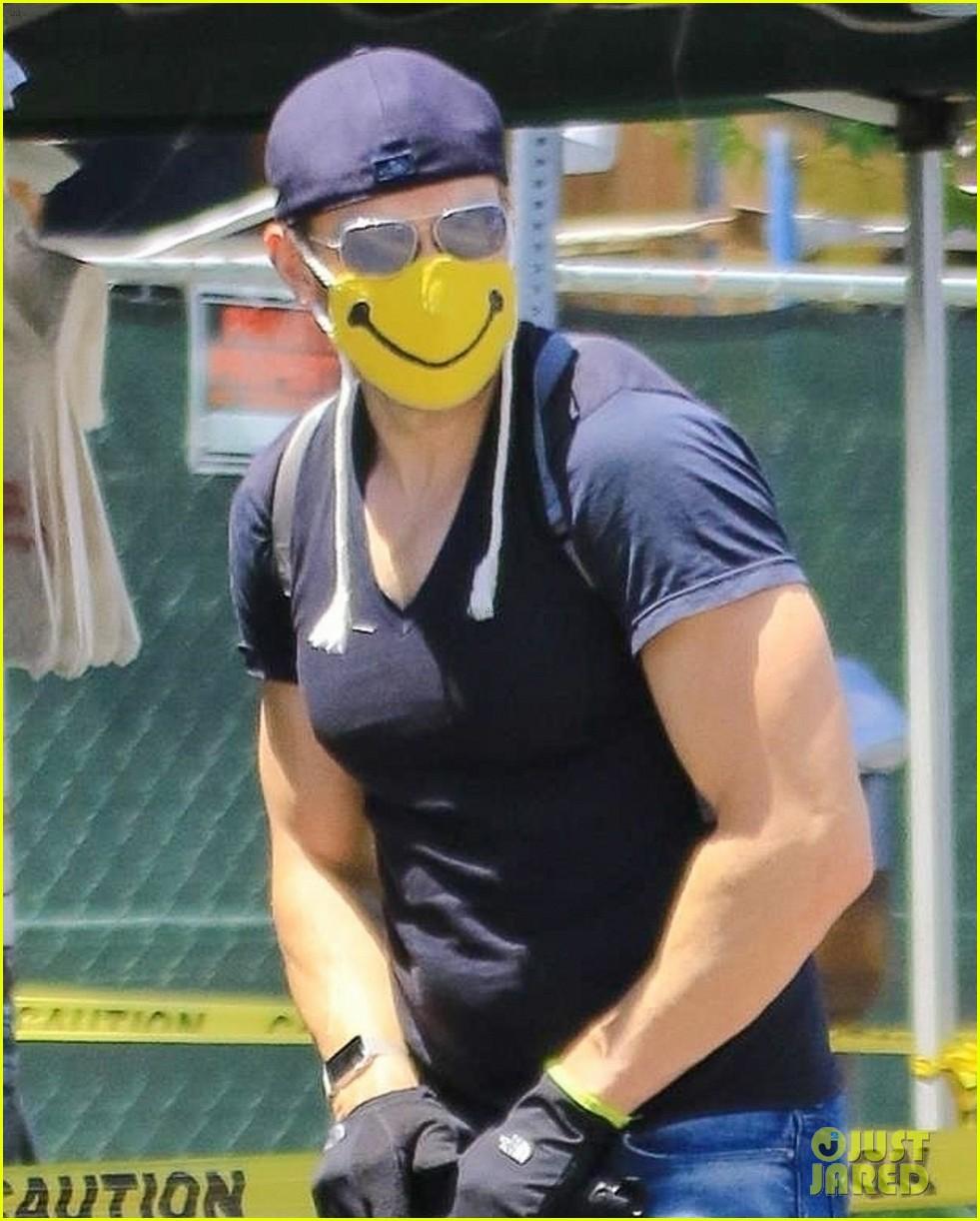 joel mchale wears smiley face mask farmers market 034457650
