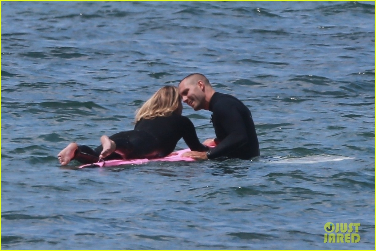 robin wright clement giraudet kisses while surfing 014462998