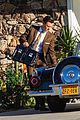 harry styles looks dapper in two suits on dont worry darling set in palm springs 10