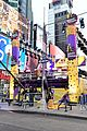 ryan seacrest lucy hale billy porter in times square 20