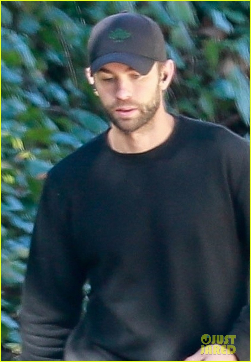 chace crawford wears all black while walking his dog 024520948