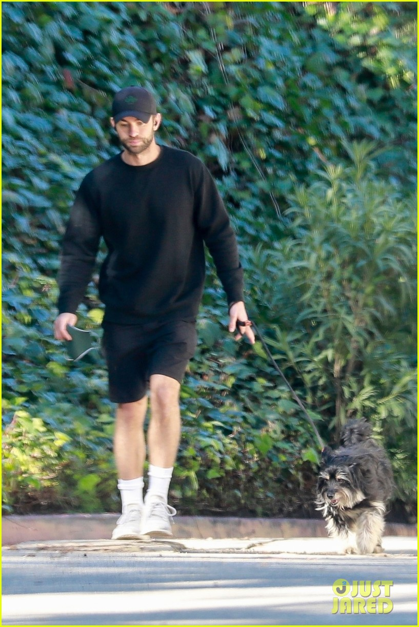 chace crawford wears all black while walking his dog 034520949