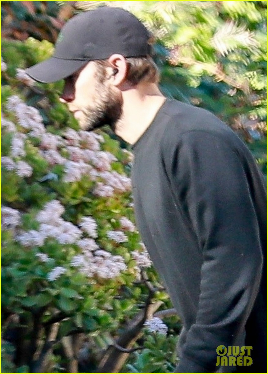chace crawford wears all black while walking his dog 044520950