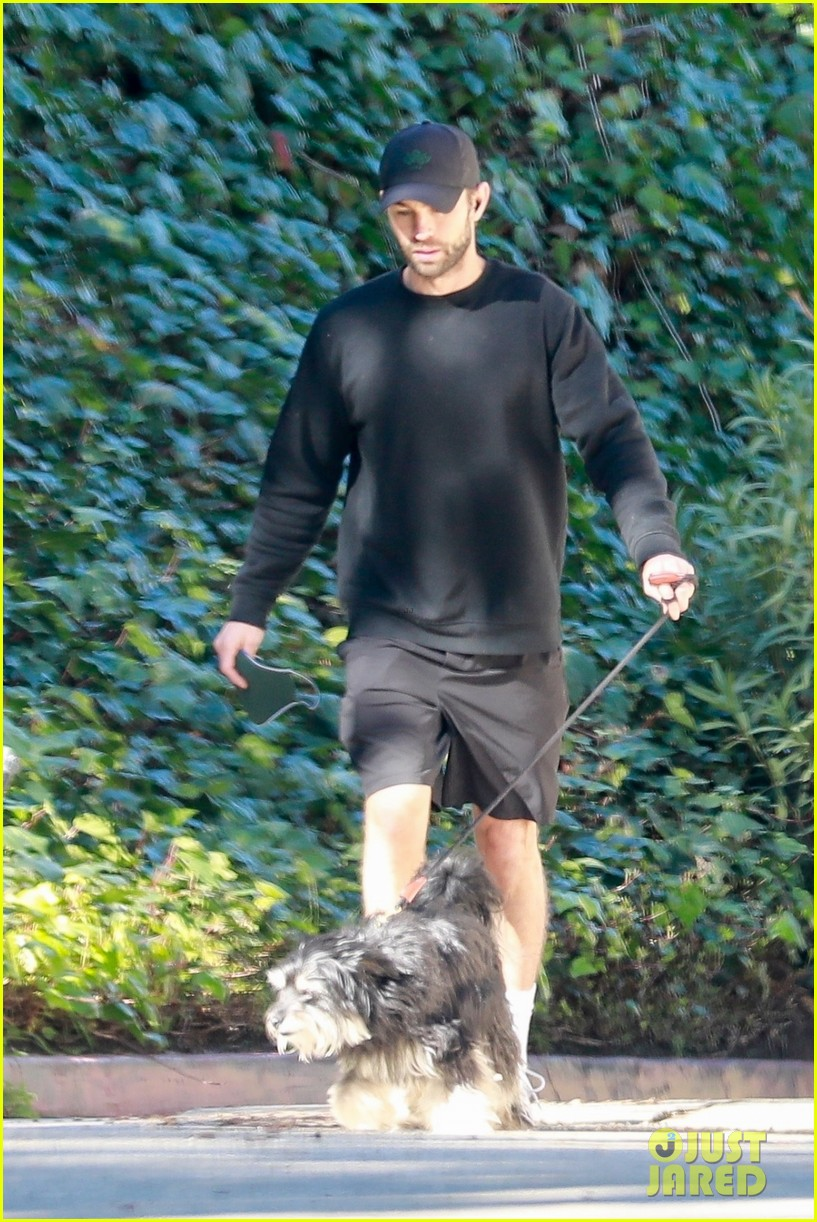 chace crawford wears all black while walking his dog 074520953