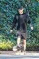 chace crawford wears all black while walking his dog 07