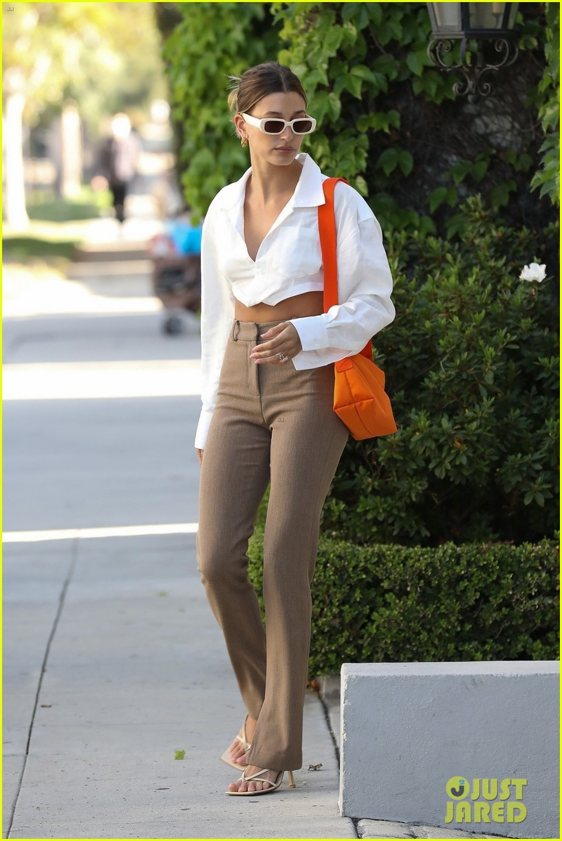 hailey bieber shows of toned midriff for business meeting 03