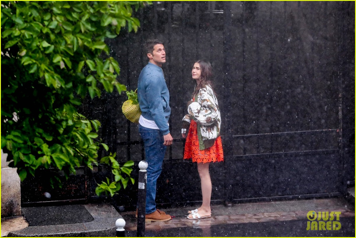 lily collins caught in rain with lucas bravo emily in paris 054557981