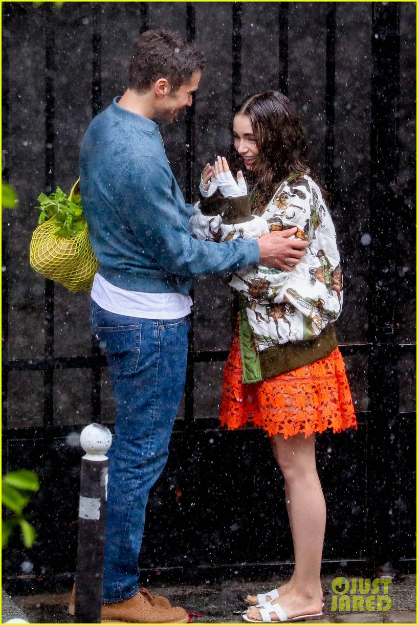 lily collins caught in rain with lucas bravo emily in paris 084557984