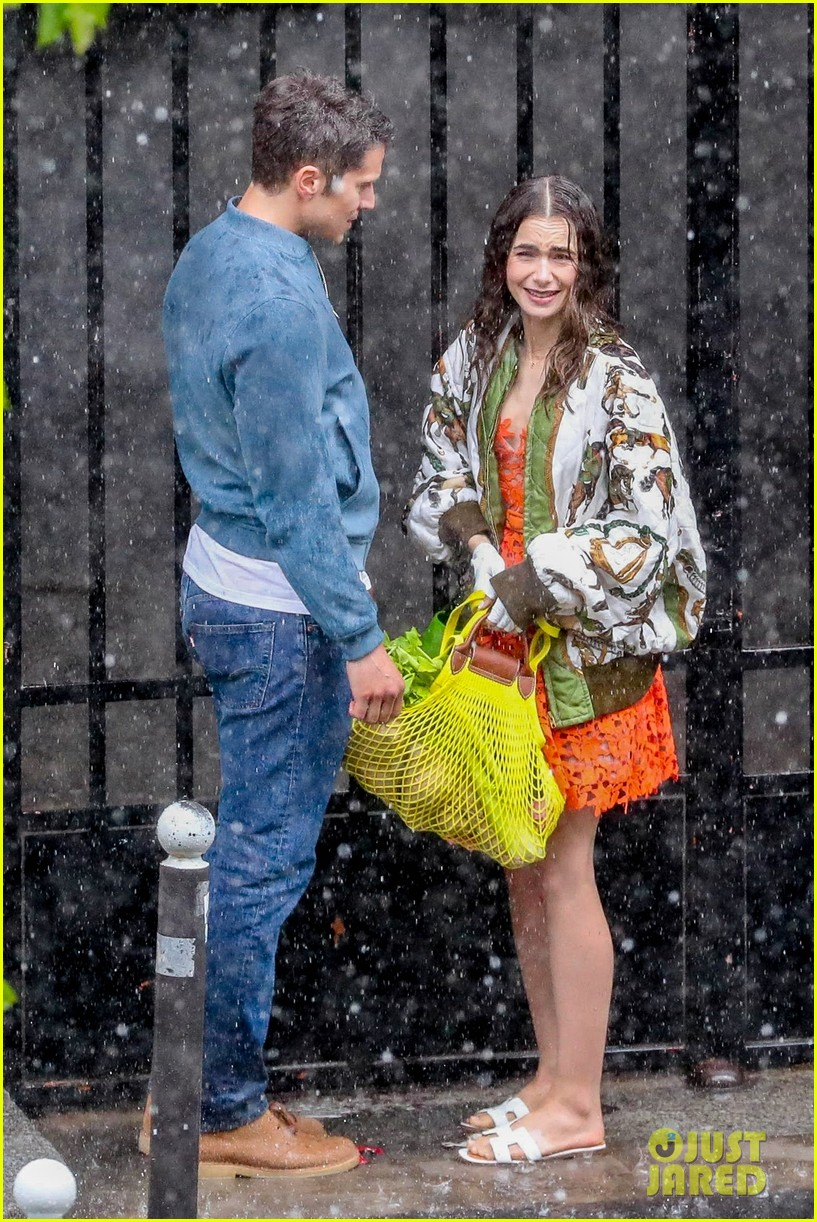 lily collins caught in rain with lucas bravo emily in paris 094557985