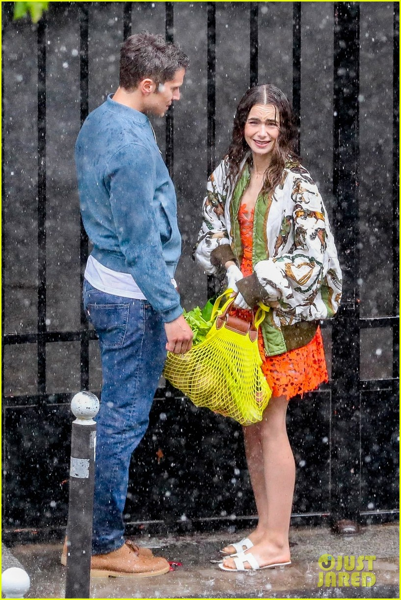 lily collins caught in rain with lucas bravo emily in paris 124557988