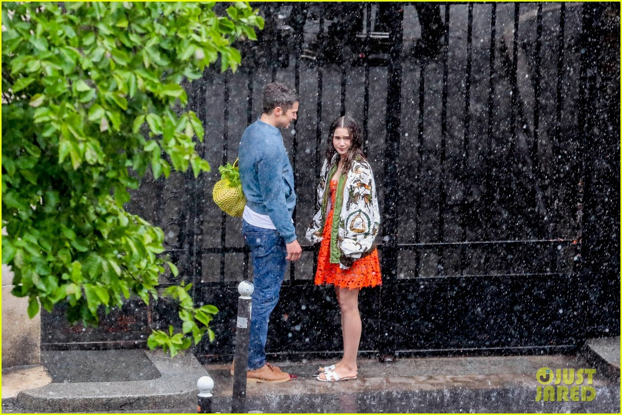 lily collins caught in rain with lucas bravo emily in paris 134557989