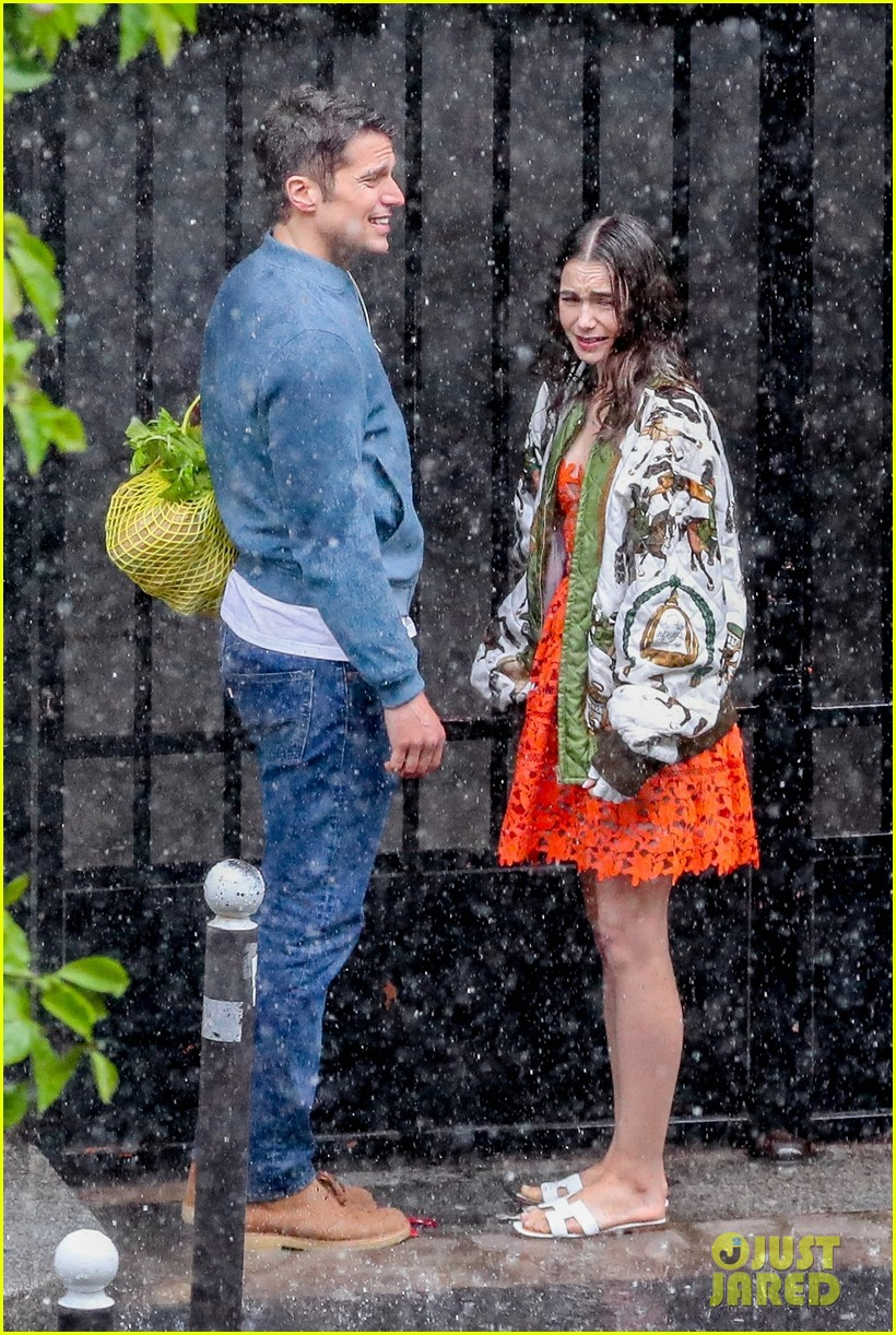 lily collins caught in rain with lucas bravo emily in paris 144557990