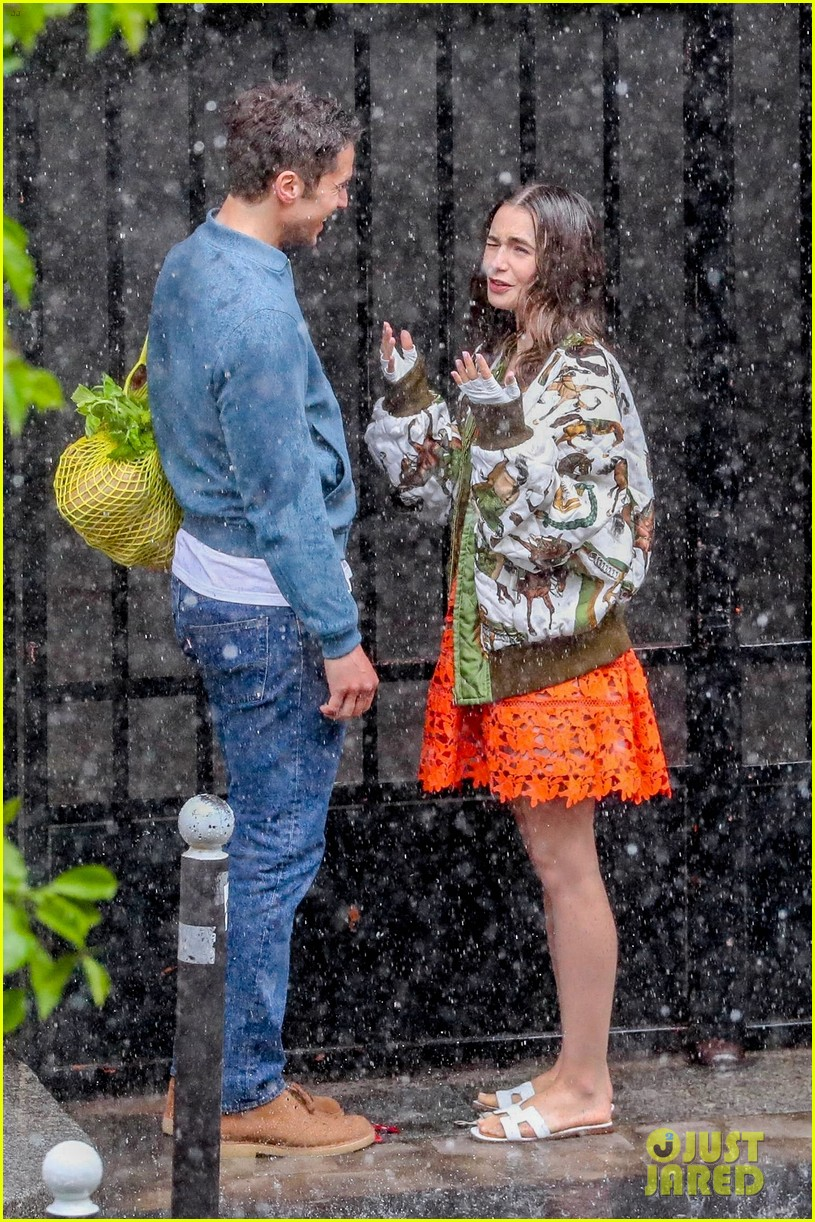 lily collins caught in rain with lucas bravo emily in paris 174557993