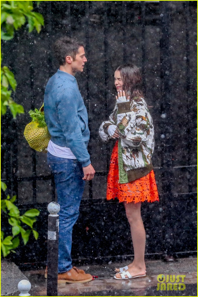 lily collins caught in rain with lucas bravo emily in paris 214557997