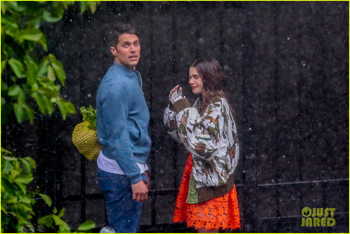 lily collins caught in rain with lucas bravo emily in paris 224557998