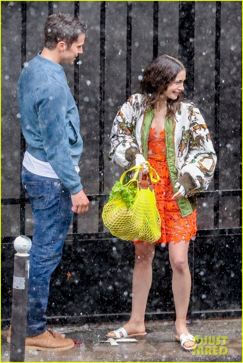 lily collins caught in rain with lucas bravo emily in paris 254558001