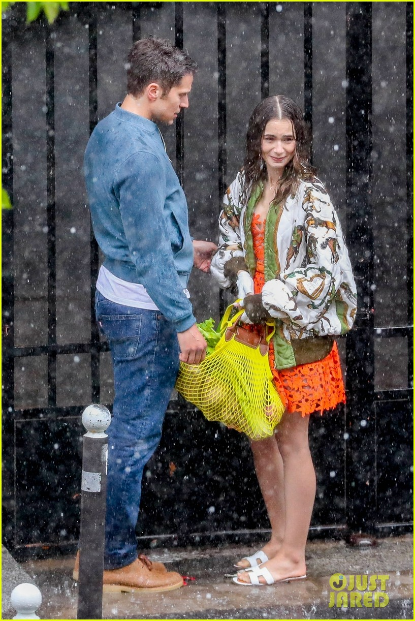 lily collins caught in rain with lucas bravo emily in paris 274558003