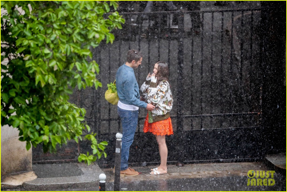 lily collins caught in rain with lucas bravo emily in paris 334558009