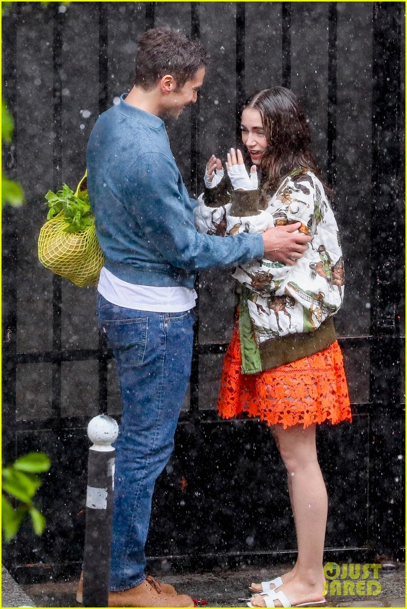 lily collins caught in rain with lucas bravo emily in paris 354558011
