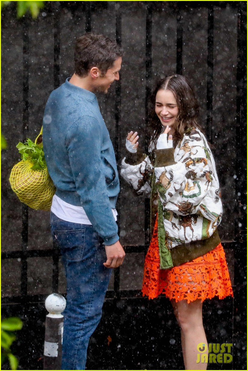 lily collins caught in rain with lucas bravo emily in paris 364558012