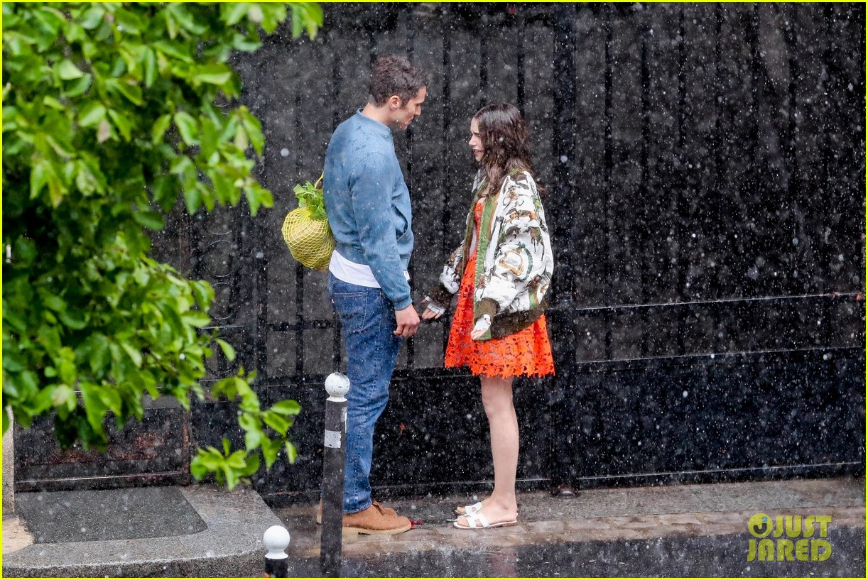 lily collins caught in rain with lucas bravo emily in paris 454558021