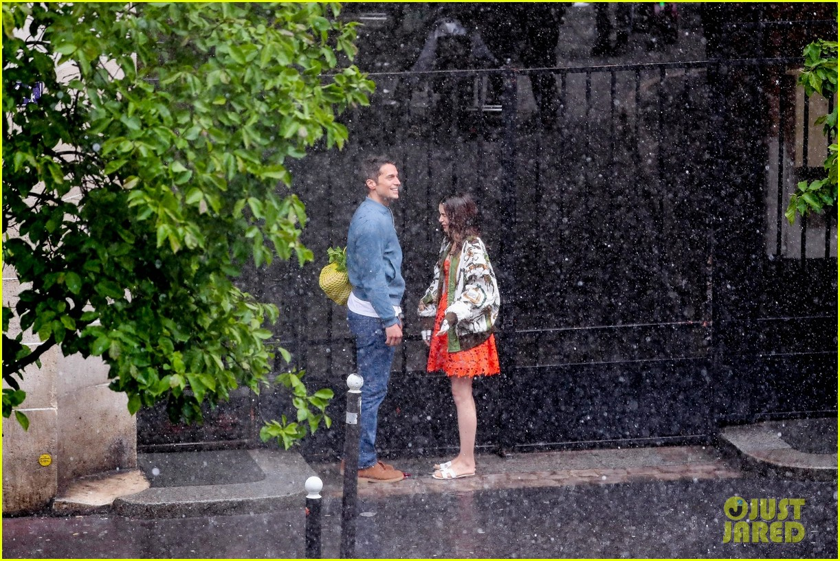 lily collins caught in rain with lucas bravo emily in paris 464558022