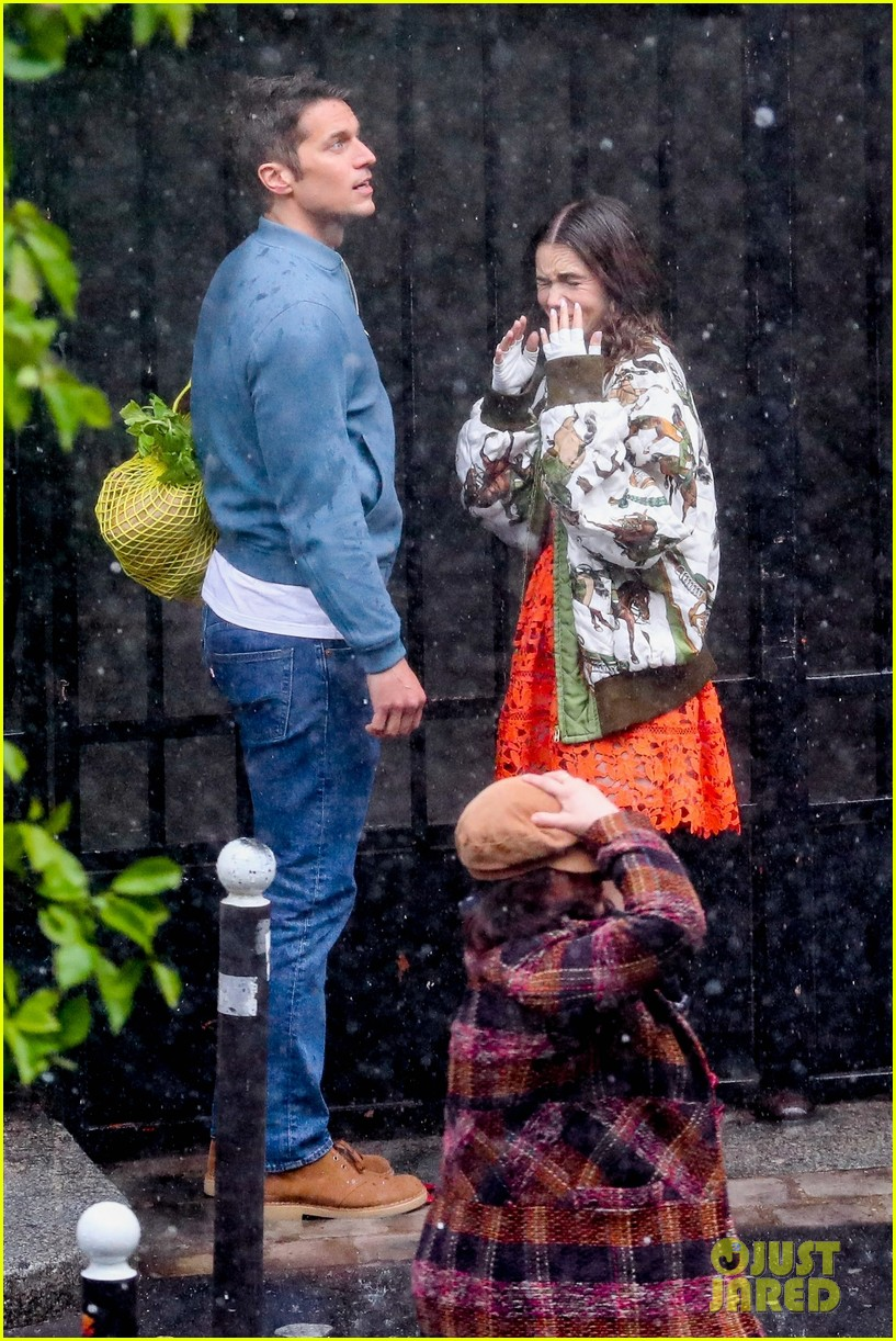 lily collins caught in rain with lucas bravo emily in paris 494558025