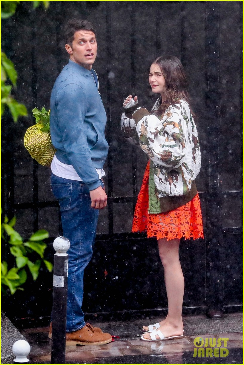 lily collins caught in rain with lucas bravo emily in paris 504558026