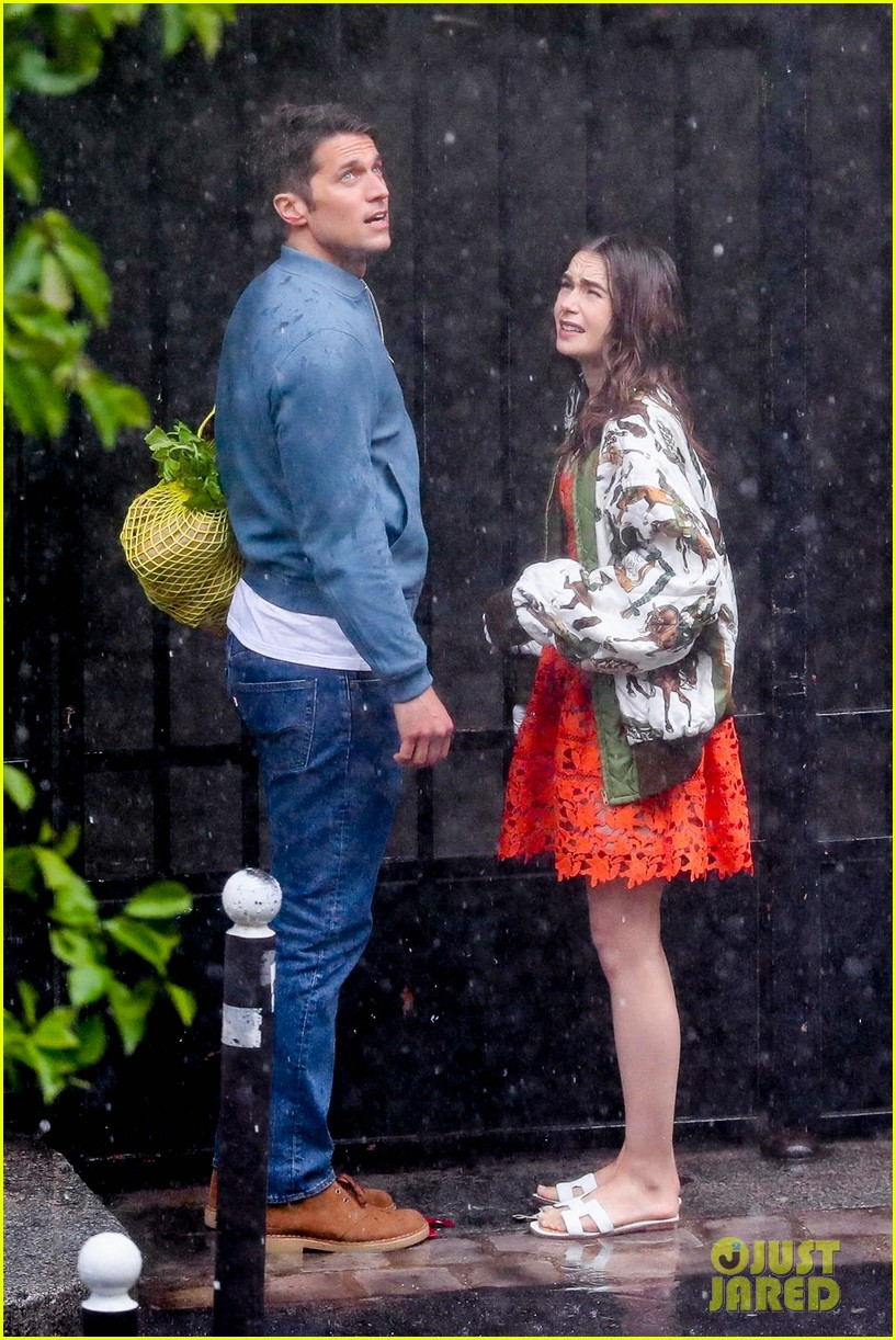 lily collins caught in rain with lucas bravo emily in paris 514558027