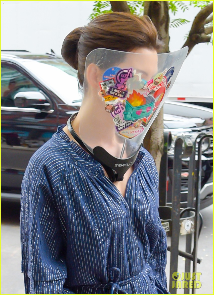 anne hathaway wears face shield covered with stickers on wecrashed set 044575111