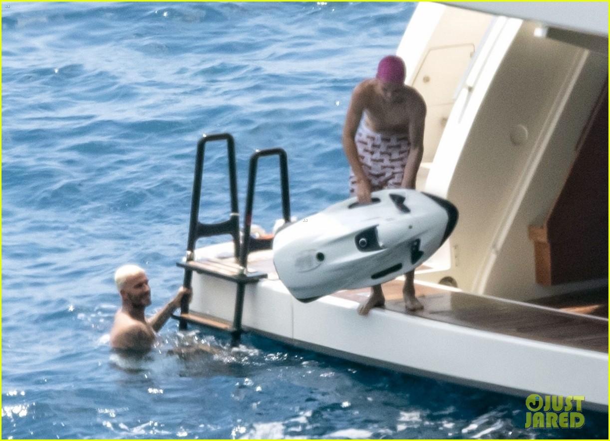 david beckham jumps off yacht with son cruz beckham 204594586