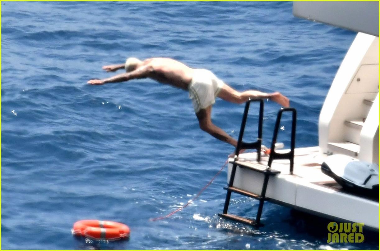 david beckham jumps off yacht with son cruz beckham 484594614