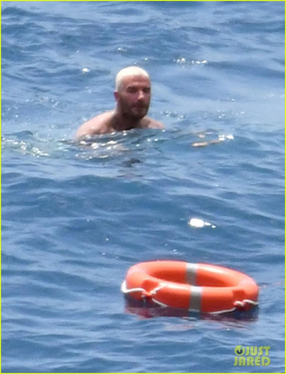 david beckham jumps off yacht with son cruz beckham 534594619