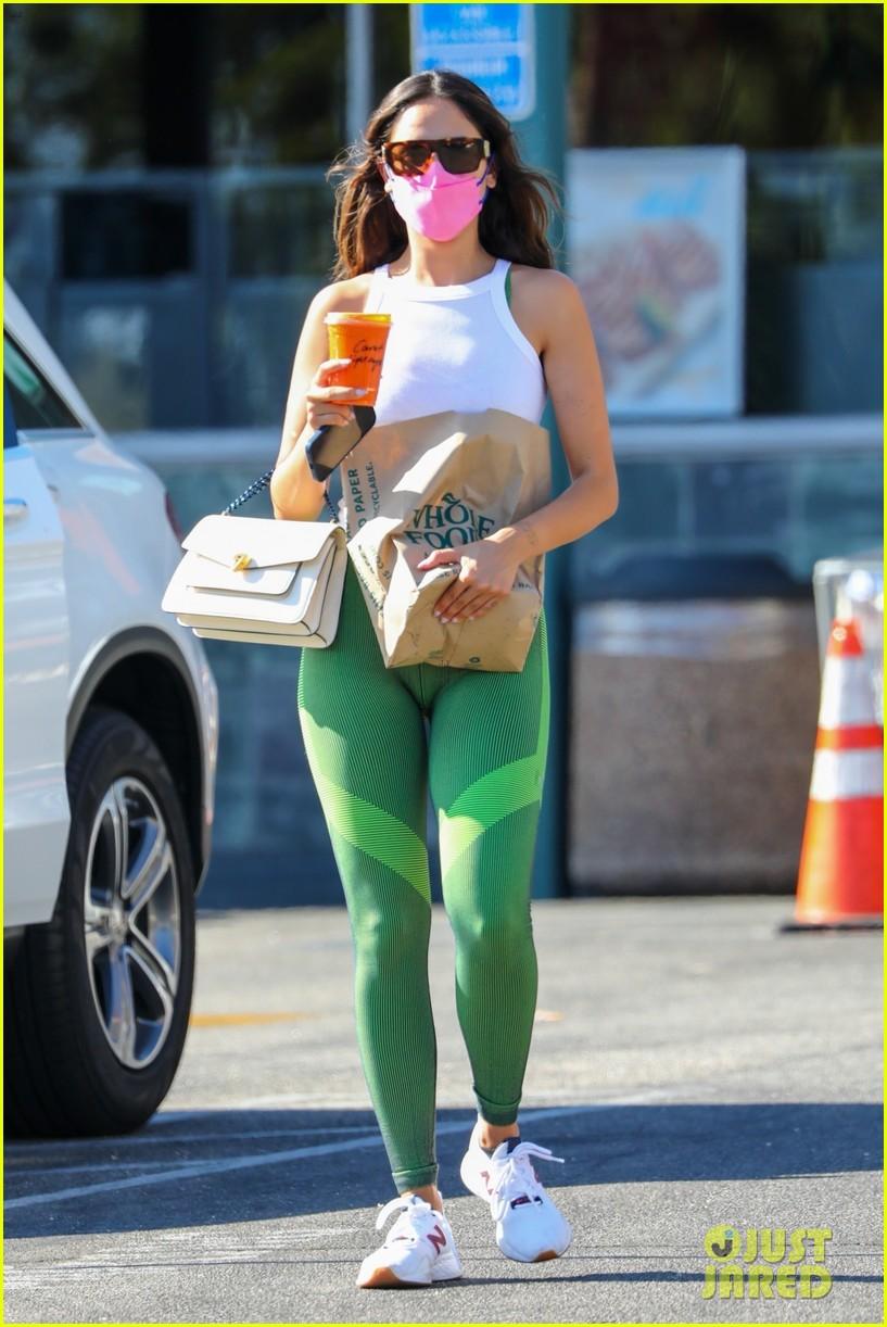 eiza gonzalez green leggings pink mask snack run 01