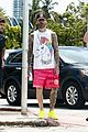 behati prinsloo at the beach while adam levine works out 06