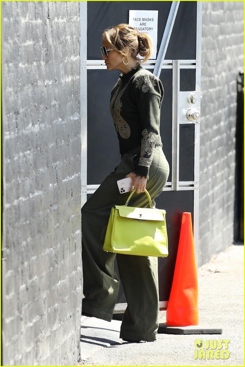 jennifer lopez lime green purse dance studio stop 074625135