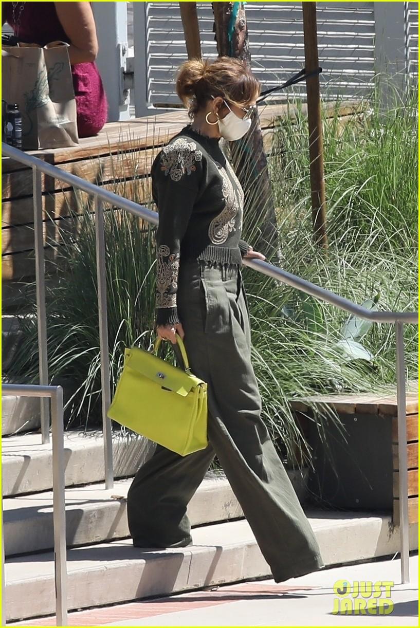 jennifer lopez lime green purse dance studio stop 104625138
