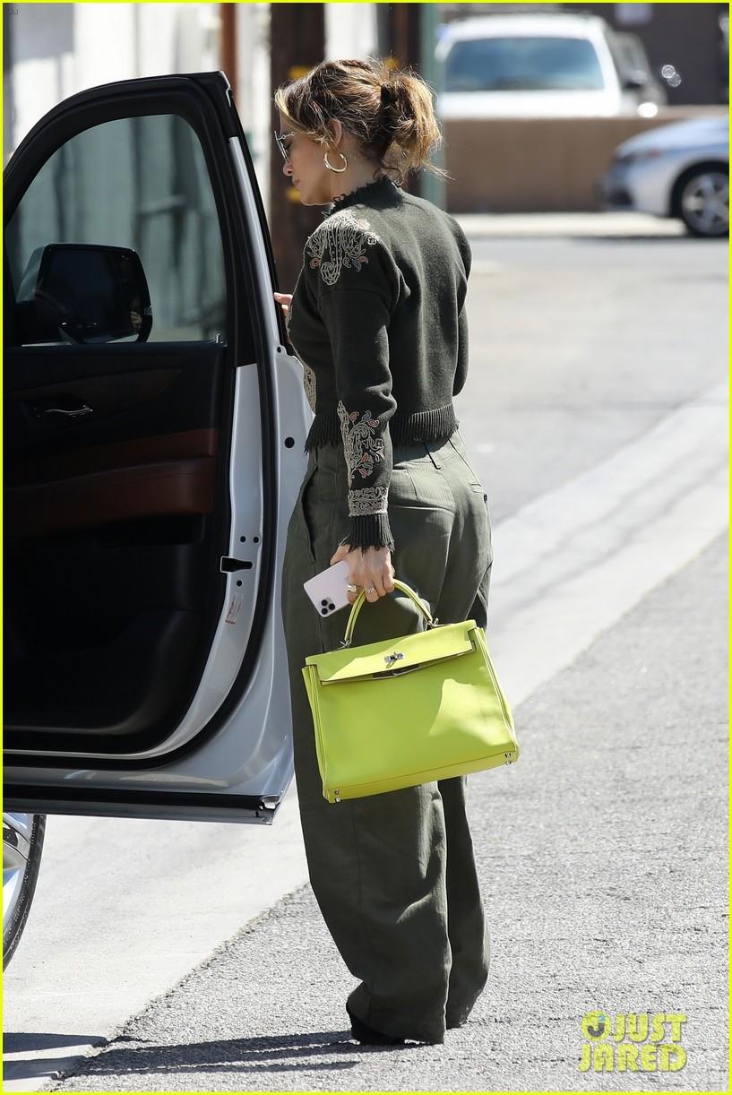 jennifer lopez lime green purse dance studio stop 144625142
