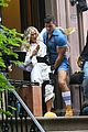 sarah jessica parker carried by hunky man on and just like that set 03