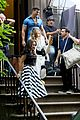 sarah jessica parker carried by hunky man on and just like that set 10