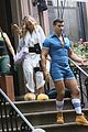 sarah jessica parker carried by hunky man on and just like that set 23