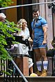 sarah jessica parker carried by hunky man on and just like that set 26
