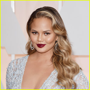 Chrissy Teigen Hilariously Reacts to Throwback Photo as 'Deal or No Deal' Briefcase Model